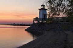 Lighthouse Landing At Dusk