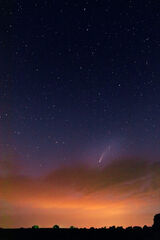 Comet Neowise Over Storm Clouds